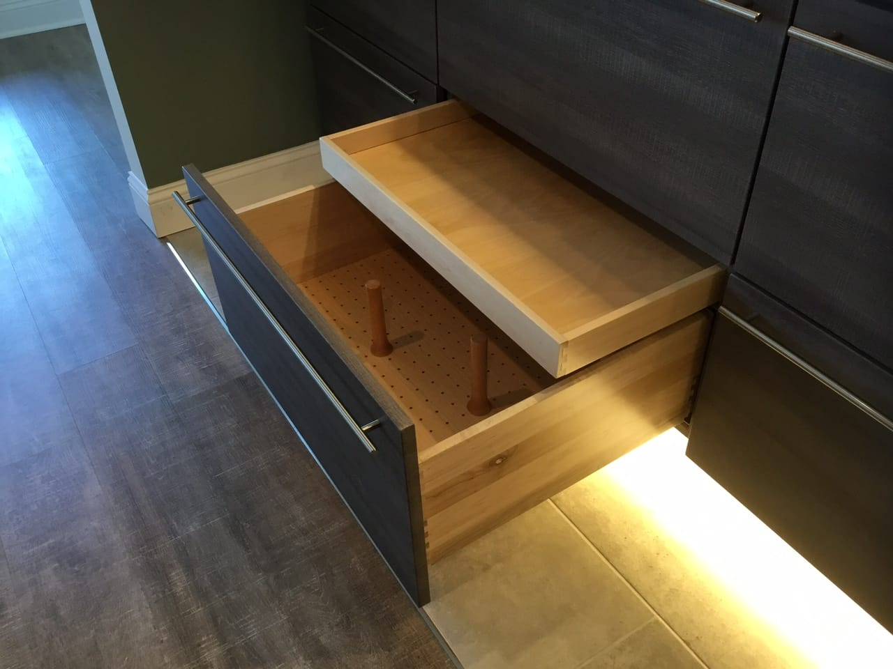 Custom kitchen cabinet drawer with peg dividers